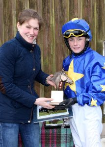 2016 Robbie Ashe receiving the JockeyJan Trophy from Lucy Alexander, leading Lady Jockey 2015/16 National Hunt Season